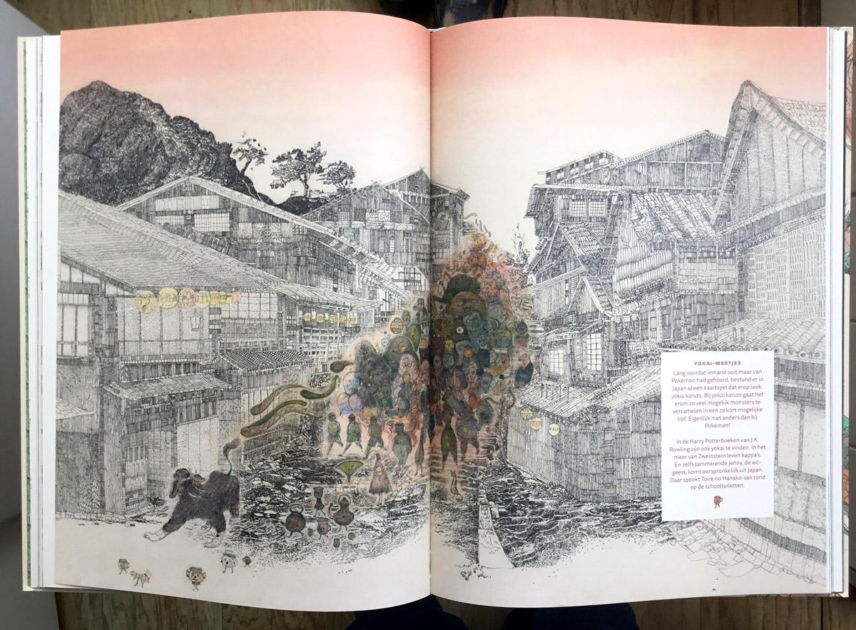Foto van een boek met over 2 pagina's een tekening